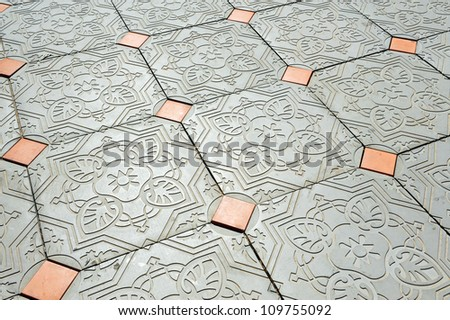 Old floor with beautiful tiles. - stock photo