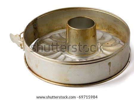 Old fluted tube baking pan isolated on white - stock photo