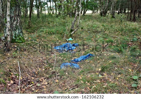 Old foil thrown in the woods - stock photo