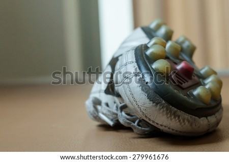 Old football shoe. - stock photo