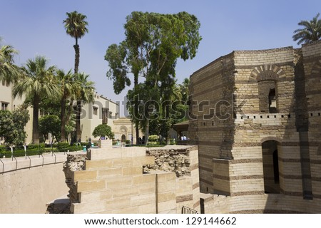 Old for of Babylon located in Old (Coptic) Cairo in Egypt. Several of the oldest christian churches are built into or on its walls. These include the Hanging Church and the Greek Church of St. George - stock photo