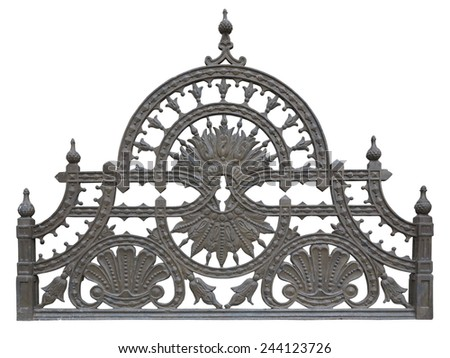 Old forged metallic decorative lattice fence isolated over white background - stock photo