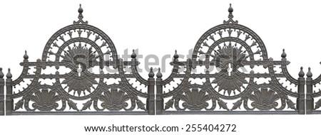 Old forged metallic decorative lattice fence isolated over white background - stock photo