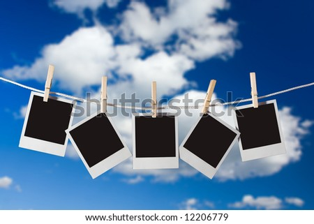 Old forms instant photo, hanging on a cord, suspended by clothespins - stock photo