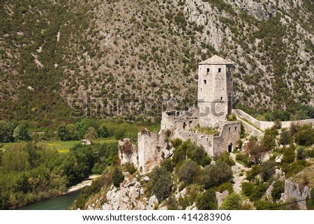 Old fortress and tower in medieval city of Pocitelj, Bosnia and Hercegovina - stock photo