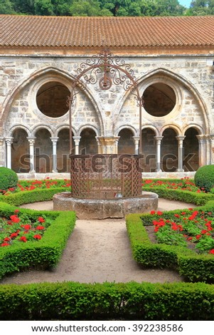 Old fountain inside the patio and cloister of Fontfroide Abbey, Languedoc-Roussillon, France - stock photo