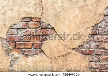 Old fragmented brick wall texture background - stock photo