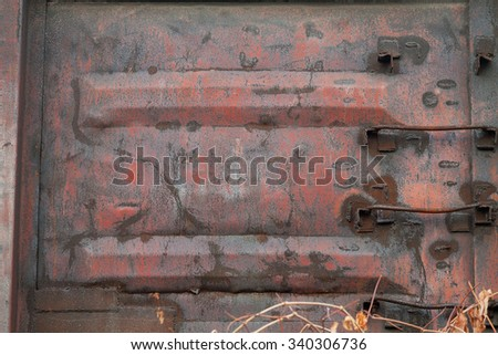 old freight wagon. texture of rusty painted metal