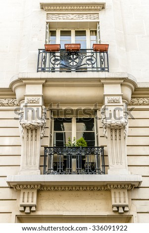 Old French house with traditional balconies and windows. Paris, France. - stock photo
