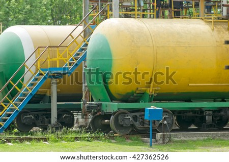 Old fuel tanks at the oil terminal on railway station on a summer day