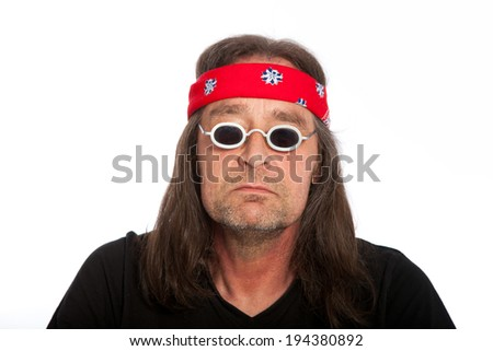 Old funky man with red turban wrapped around his head - stock photo