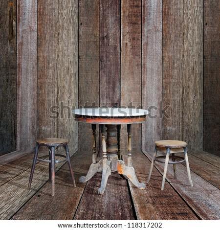 Old furniture in vintage wood room. - stock photo