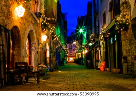 old Galway city street,Kerwan's Lane,decorated with christmas lights,night scene - stock photo
