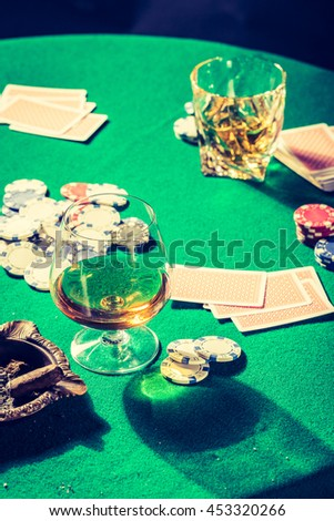 Old gambling table with chips and cards - stock photo