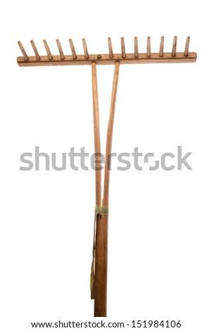 Old garden rake on white background - stock photo