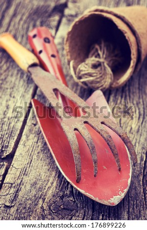 old garden tools on on a wooden background (Vintage style) - stock photo