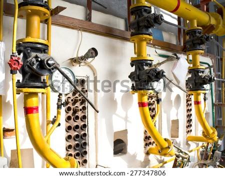 Old gas boiler in boiler room - stock photo