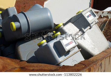old gas counters thrown in waste landfill - stock photo