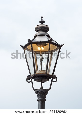 Old gas lantern is lit during the day - stock photo