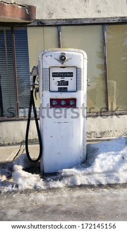 Old gas pump at an abandoned gas station - stock photo