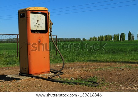 Old gas station in steppe - stock photo