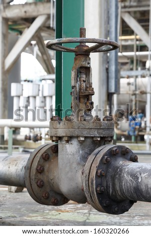 old gate valve open in dustrial plant - stock photo