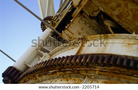 Old gears of a crane - stock photo