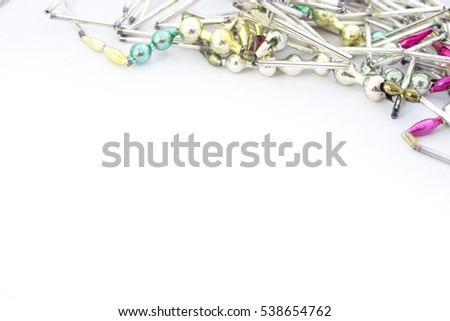 old glass Christmas garland on closeup white
