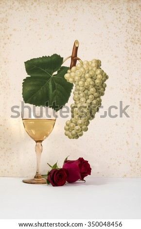 old glass of  white wine background grape cluster decorated, romantic moment and flowers rose , natural light, vertical photo - stock photo