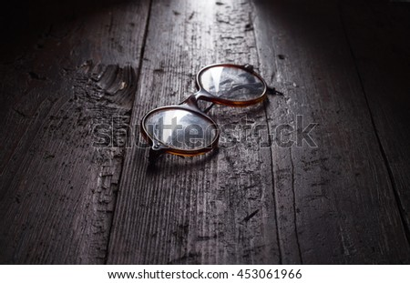 Old glasses on the wooden floor - stock photo