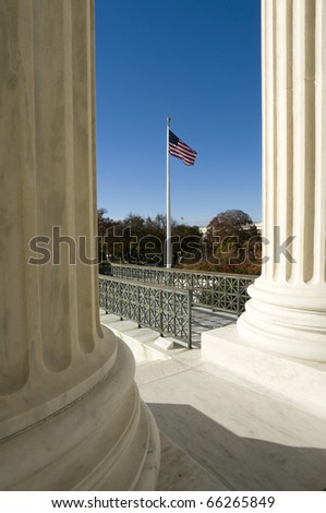 Old Glory flying in front of the US Supreme Court in Washington, DC. - stock photo