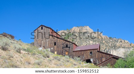 Old gold mining structure at Bayhorse, Idaho ghost town. - stock photo