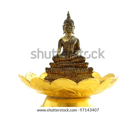 Old golden Buddha on golden tray with pedestal - stock photo