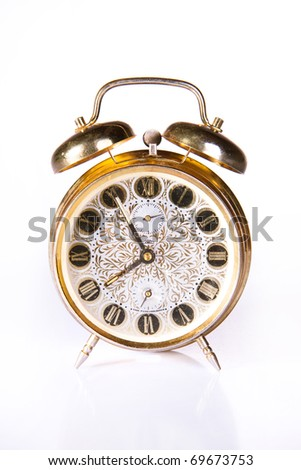 Old golden clock isolated over white - stock photo