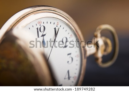 Old golden pocket watch macro shot with selective focus. - stock photo