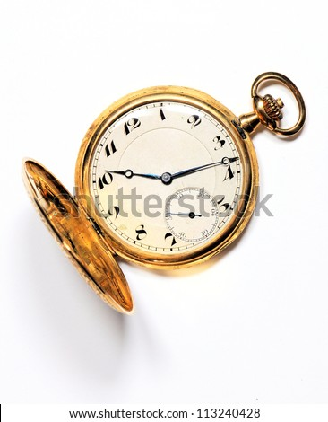 Old golden pocket watch on white background