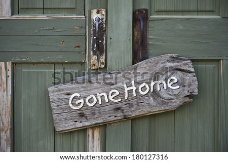 Old gone home sign. - stock photo