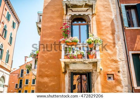 Old gothic house facade with beautiful balcony in Venice