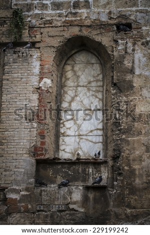 old gothic window, Spanish city of Valencia, Mediterranean architecture - stock photo