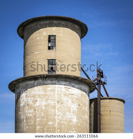 Old Grain Elevator against a Blue Sky - stock photo