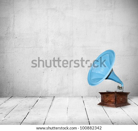 Old gramophone in the vintage room - stock photo