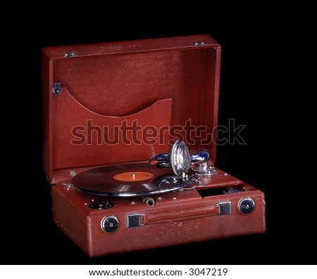 old gramophone isolated on black - stock photo