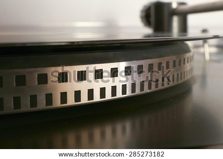old gramophone turntable with disc, detail, photo - stock photo