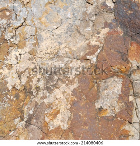 Old granite stone texture with cracks - stock photo
