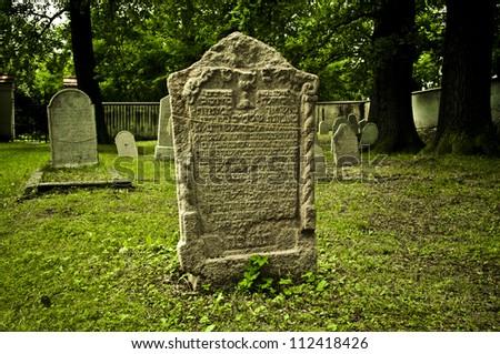old gravestone in Jewish cemetery - stock photo