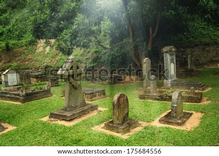 old graveyard with light - stock photo