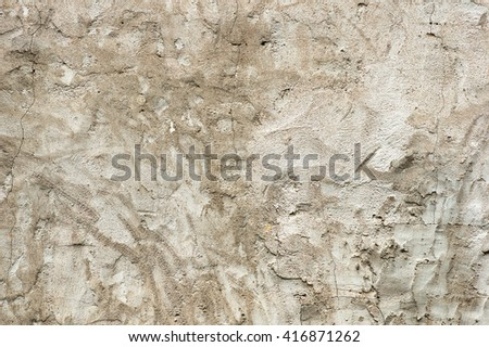 old gray cracked stucco wall background texture - stock photo