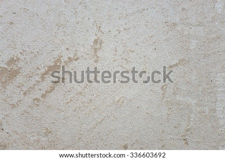 Old gray scratched cement wall. Texture. Background - stock photo