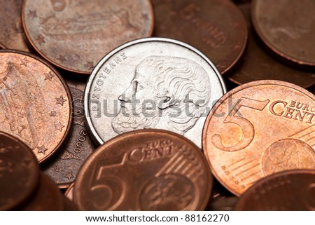 Old Greek coin among euro coins, drachmas (with the face of Aristotle, the ancient Greek  philosopher) - stock photo
