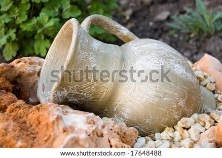 Old Greek jug on stones - stock photo